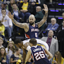 Indiana Pacers' Paul George (24) is defended by Atlanta Hawks' Pero Antic (6) and Kyle Korver (26) during the first half in Game 2 of an opening-round NBA basketball playoff series Tuesday, April 22, 2014, in Indianapolis The Associated Press