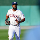 Washington Nationals outfielder Denard Span returns to the dugout after the top of the first inning as the Hagerstown Suns center fielder against the Lakewood BlueClaws in a baseball game on Thursday, April 17, 2014, in Hagerstown, Md. Span was making a r
