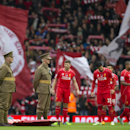 Liverpool players including captain Steven Gerrard, centre left, prepare to line up for a minutes silence before Remembrance Sunday before the English Premier League soccer match between Liverpool and Chelsea at Anfield Stadium, Liverpool, England, Saturd