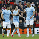 Manchester City's Sergio Aguero, left, celebrates scoring a goal with teammates Samir Nasri, centre, and Yaya Toure during the English Premier League soccer match between Southampton and Manchester City at St Mary's Stadium in Southampton, England, Saturd