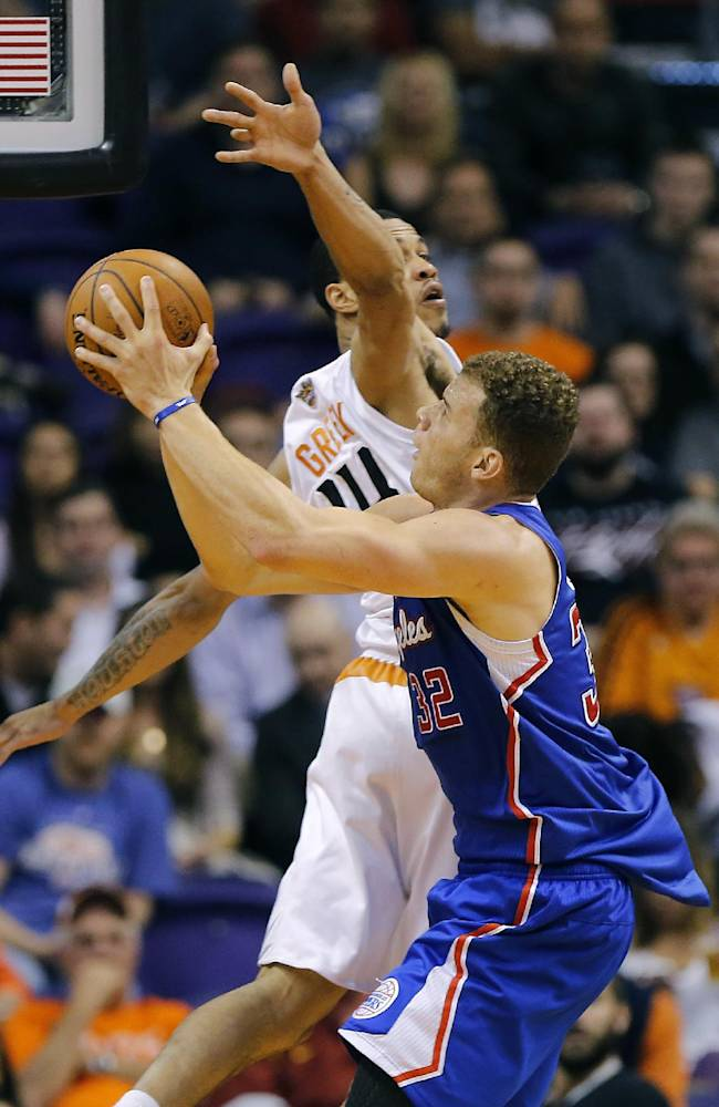Phoenix Suns' Gerald Green, rear, tries to stop Los Angeles Clippers' Blake Griffin from scoring during the second half of an NBA basketball game, Tuesday, March 4, 2014, in Phoenix. The Clippers won 104-96