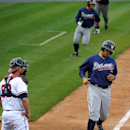 Future Stars' Edison Sanchez, right, and Tanner Murphy, rear, score in front of Atlanta Braves catcher Gerald Laird on the two run double by Joe Odom in the eighth inning of an exhibition baseball game Saturday, March 29, 2014, in Rome, Ga. The Future Sta