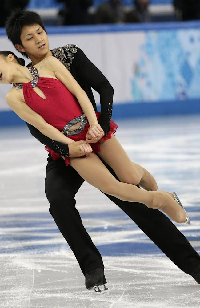 Narumi Takahashi and Ryuichi Kihara of Japan compete in the team pairs short program figure skating competition at the Iceberg Skating Palace during the 2014 Winter Olympics, Thursday, Feb. 6, 2014, in Sochi, Russia