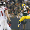 Green Bay Packers' Randall Cobb goes up for a pass against Atlanta Falcons' Kroy Biermann (71) during the second half of an NFL football game Monday, Dec. 8, 2014, in Green Bay, Wis The Associated Press
