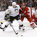 Detroit Red Wings left wing Henrik Zetterberg (40), of Sweden, defends Pittsburgh Penguins center Sidney Crosby (87) in the third period of an NHL hockey game in Detroit, Thursday, Oct. 23, 2014 The Associated Press