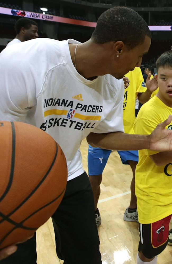 Indiana Pacers' George Hill conducts a basketball clinic for Filipino Special Olympics athletes Wednesday, Oct. 9, 2013, at the Mall of Asia Arena in Pasay city, south of Manila, Philippines. The Indiana Pacers will play against the Houston Rockets on Thursday in the first NBA game in this basketball-obsessed Southeast Asian nation, part of the NBA's global schedule that will have eight teams play in six countries this month