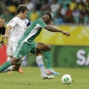 Uruguay's Diego Lugano challenges Nigeria's Brown Ideye, right, during the soccer Confederations Cup group B match between Nigeria and Uruguay at Fonte Nova stadium in Salvador, Brazil, Thursday, June 20, 2013. (AP Photo/Natacha Pisarenko)