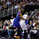 Philadelphia 76ers' James Anderson, left, steps on the ball after chasing it out of bounds with Detroit Pistons' Josh Smith during the first half of an NBA basketball game on Saturday, March 29, 2014, in Philadelphia The Associated Press