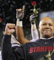 Stanford head coach David Shaw holds a rose after the NCAA Pac-12 Championship football game, Saturday, Dec. 7, 2013, in Tempe, Ariz. Stanford defeated Arizona State 38-14.(AP Photo/Matt York)