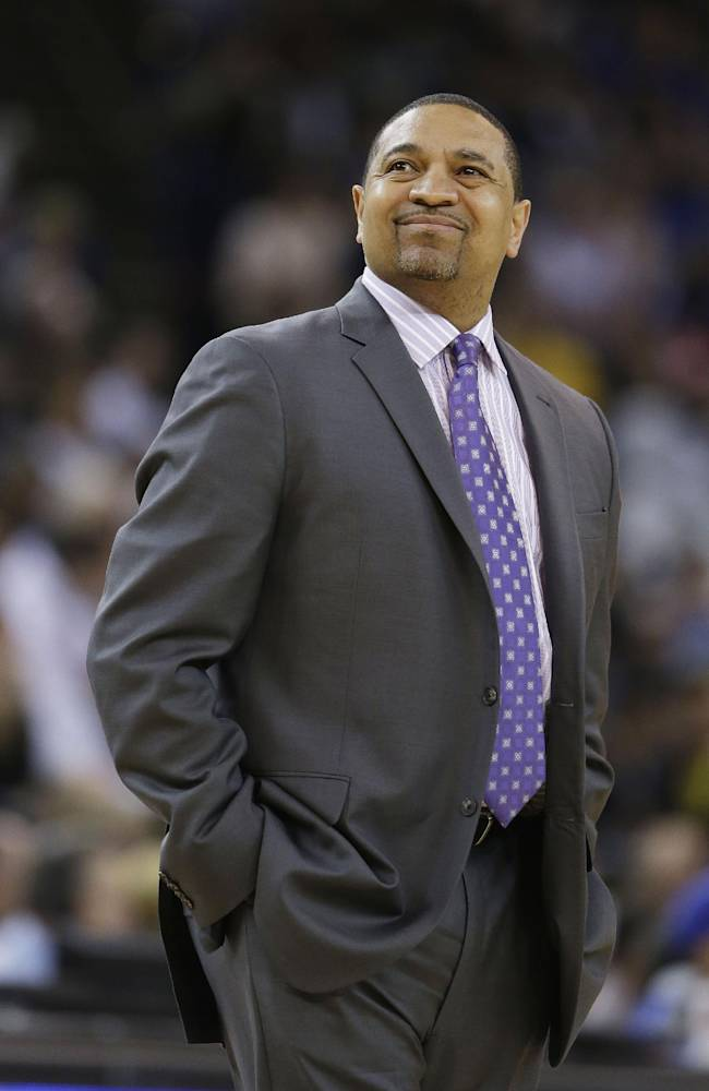 Golden State Warriors coach Mark Jackson looks up at the scoreboard after calling a time out during the first quarter of the Warriors' NBA basketball game against the San Antonio Spurs Saturday, March 22, 2014, in Oakland, Calif