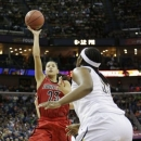 Louisville guard Shoni Schimmel (23) shoots in the first half of a national semifinal at the Women's Final Four of the NCAA college basketball tournament, Sunday, April 7, 2013, in New Orleans. (AP Photo/Gerald Herbert)