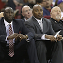 Utah Jazz head coach Ty Corbin, left, and assistant coach Sidney Lowe, center, watch the action in the Jazz' 122-101 win over the Sacramento Kings in an NBA basketball game in Sacramento, Calif., Wednesday, Dec. 11, 2013. Earlier in the day Lowe, the