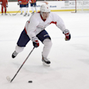Washington Capitals center Nicklas Backstrom (19), of Sweden, skates with the puck during NHL hockey training camp, Friday, Sept. 19, 2014, in Arlington, Va The Associated Press