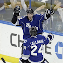 Tampa Bay Lightning defenseman Andrej Sustr (62), of the Czech Republic, celebrates with teammate Ryan Callahan (24) after scoring against the Dallas Stars during the second period of an NHL hockey game on Saturday, April 5, 2014, in Tampa, Fla The Associ