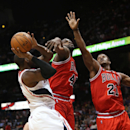 Atlanta Hawks forward Paul Millsap (4) attempts a shot as Chicago Bulls center Nazr Mohammed (48) and guard Jimmy Butler (21) defend during the first half of an NBA basketball game Wednesday, April 2, 2014, in Atlanta The Associated Press