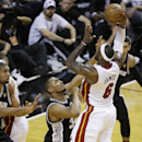 San Antonio Spurs center Boris Diaw (33) of France, defends against Miami Heat small forward LeBron James (6) during the first half of Game 6 of the NBA Finals basketball game, Tuesday, June 18, 2013 in Miami. (AP Photo/Wilfredo Lee)
