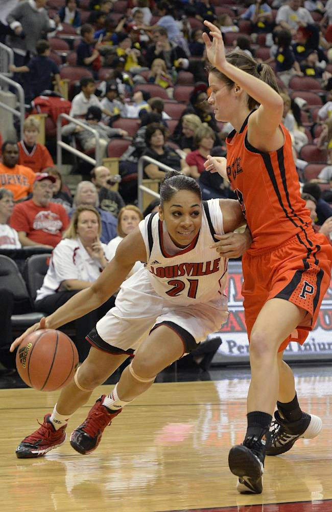 Louisville's Bria Smith, left, drives under the defense of Pikeville's Kandice Porter during the second half of an NCAA college basketball exhibition game, Tuesday, Nov. 5, 2013, in Louisville, Ky. Louisville defeated Pikeville 127-40