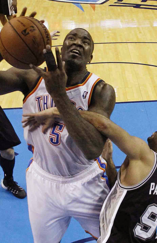 Oklahoma City Thunder center Kendrick Perkins (5) is fouled by San Antonio Spurs guard Tony Parker (9) in the third quarter of Game 3 of an NBA basketball playoff series in the Western Conference finals, Sunday, May 25, 2014, in Oklahoma City. Oklahoma City won 106-97