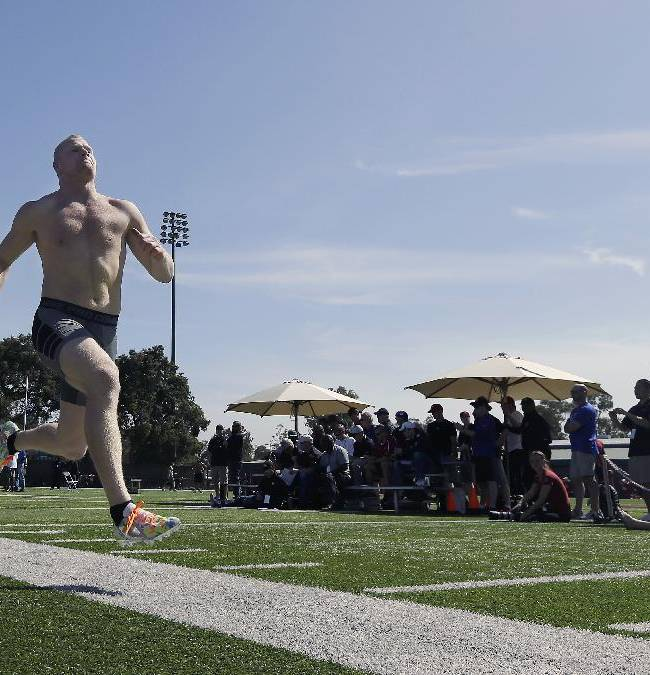 Stanford linebacker Trent Murphy runs during pro day for NFL football representatives in Stanford, Calif., Thursday, March 20, 2014