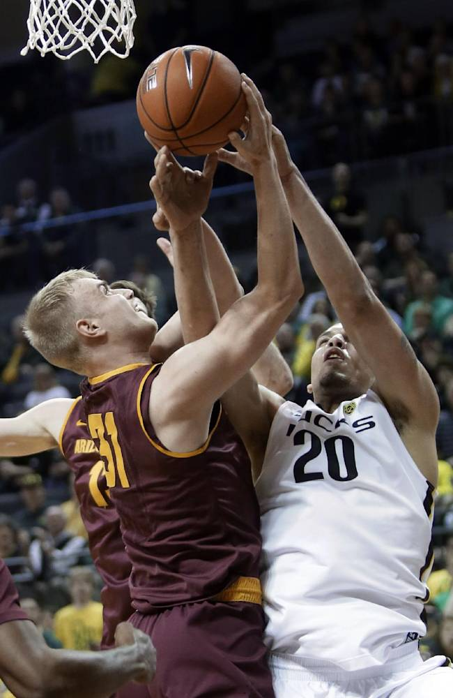 Arizona State forward Jonathan Gilling, left, and Oregon center Waverly Austin vie for a rebound during the first half of an NCAA college basketball game in Eugene, Ore., Tuesday, March 4, 2014