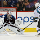 Colorado Avalanche goalie Semyon Varlamov, left, of Russia, stops a shot off the stick of San Jose Sharks left wing Patrick Marleau during the shootout in the Sharks' 3-2 shootout victory in an NHL hockey game in Denver on Tuesday, Oct. 28, 2014 The Assoc