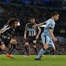 Manchester City's Samir Nasri, right, keeps the ball from Newcastle's Fabrizio Coloccini, left, during the English League Cup soccer match between Manchester City and Newcastle at the Etihad Stadium, Manchester, England, Wednesday Oct. 29, 2014