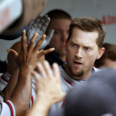 Atlanta Braves' Chris Johnson celebrates his home run off Chicago Cubs starting pitcher Scott Baker in the dugout during the second inning of a baseball game Friday, Sept. 20, 2013, in Chicago The Associated Press