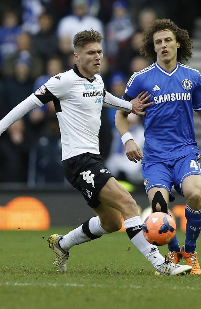 Chelsea's David Luiz, right, vies for the ball with Derby's Jeff Hendrick during the English FA Cup third round soccer match between Derby County and Chelsea at the iPro Stadium in Derby, England, Sunday, Jan. 5, 2014