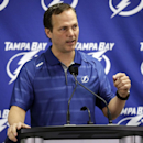 Tampa Bay Lightning head coach Jon Cooper gestures as he talks about the trade of team captain Martin St. Louis to the New York Rangers, Wednesday, March 5, 2014, in Tampa, Fla. The Lightning got Ryan Callahan and a first and conditional second round draf