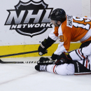 Philadelphia Flyers' Scott Hartnell (19) and Chicago Blackhawks' Duncan Keith (2) collide while chasing the puck during overtime of an NHL hockey game, Tuesday, March 18, 2014, in Philadelphia. Philadelphia won 3-2 The Associated Press