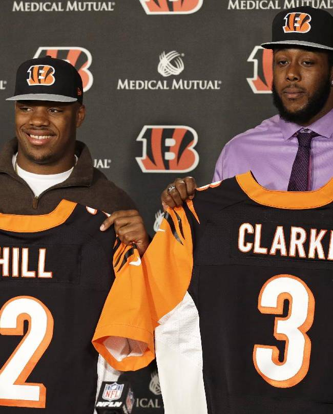 Cincinnati Bengals second round draft pick Jeremy Hill (2), a running back from LSU, and Will Clarke (3), a defensive end from West Virginia, are introduced during a news conference, Saturday, May 10, 2014, at the NFL football team's stadium in Cincinnati