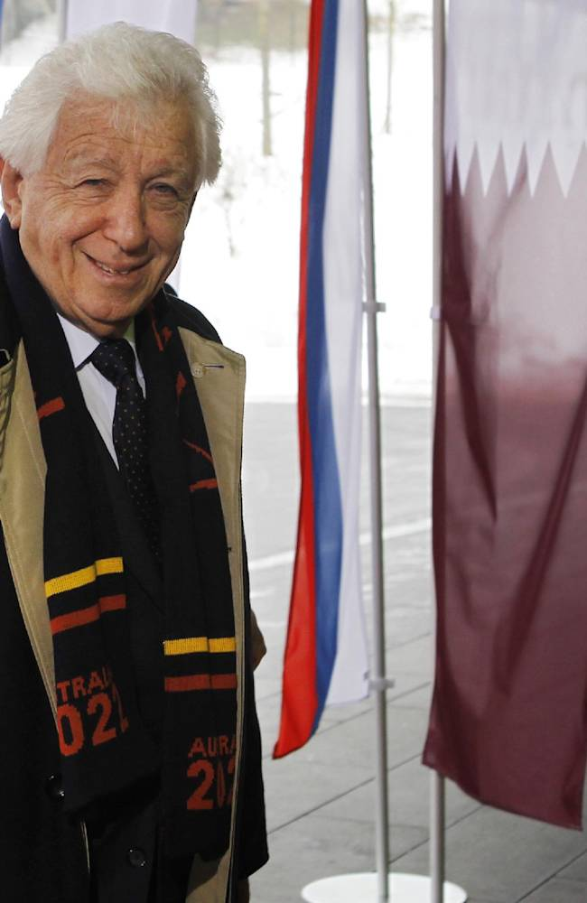In this Dec. 1, 2010 file photo, Football Federation Australia chairman Frank Lowy arrives for Australia's presentation at the FIFA headquarters in Zurich, Switzerland. Lowy has urged FIFA to wait until after an investigation into the 2022 World Cup bid process before making any decisions about shifting the dates for the event to avoid Qatar's searing summer heat. In an FFA statement Tuesday, Sept. 17, 2013, Lowy says FIFA should