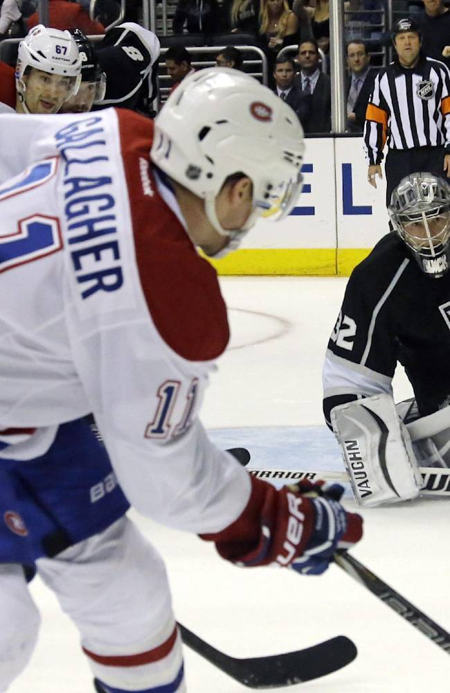 Los Angeles Kings goalie Jonathan Quick (32) defends as Montreal Canadiens right winger Brendan Gallagher (11) lines up to shoot in the final minute of the third period of an NHL hockey game in Los Angeles, Monday, March 3, 2014. The Kings won, 2-1