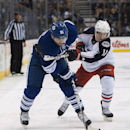Toronto Maple Leafs' Phil Kessel, left, works against Columbus Blue Jackets' Matt Calvert during the second period of an NHL hockey game in Toronto on Monday, Nov. 25, 2013 The Associated Press