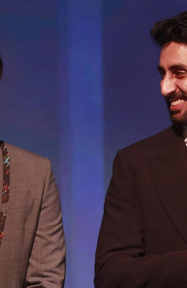 Bollywood actor and co-owner of Mumbai City FC Ranbir Kapoor, left, listens to Bollywood actor and co-owner of Team Chennai Abhishek Bachchan during the official launch of the Indian Super League (ISL) in Mumbai, India, Thursday, Aug. 28, 2014. The ISL, an initiative to popularize soccer in the country, is scheduled to begin Oct. 12