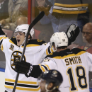 Boston Bruins' Reilly Smith (18) celebrates with Torey Krug (47) after Krug scored against the Florida Panthers during the third period of an NHL hockey game in Sunrise, Fla., Sunday, March 9, 2014. Boston won 5-2 The Associated Press