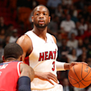 MIAMI, FL - March 10: Dwyane Wade #3 of the Miami Heat dribbles the ball against the Washington Wizards at the American Airlines Arena in Miami, Florida on March 10 2014. (Photo by Issac Baldizon/NBAE via Getty Images)