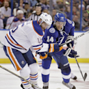 Edmonton Oilers right wing Teddy Purcell (16) battles for a loose puck with Tampa Bay Lightning right wing Brett Connolly (14) during the first period of an NHL hockey game Thursday, Jan. 15, 2015, in Tampa, Fla The Associated Press