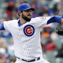 Chicago Cubs starter Carlos Villanueva throws against the Philadelphia Phillies during the first inning of a baseball game in Chicago, Sunday, April 6, 2014 The Associated Press
