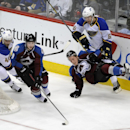 St. Louis Blues center Maxim Lapierre, left, pursues Colorado Avalanche center Matt Duchene, center left, as Avalanche defenseman Tyson Barrie, bottom right, falls down next to Blues left wing Magnus Paajarvi, top right, of Sweden, in the third period of