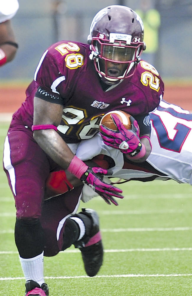 In this photo Oct. 15, 2011 file photo, Bloomsburg's Franklyn Quiteh, left, is tackled by Shippensburg's Tyriq Kershaw during a college football game in Bloomsburg, Pa. West Texas A&M quarterback Dustin Vaughan and Bloomsburg's Quiteh have been selected to The Associated Press Little All-America team, Thursday, Dec. 19, 2013, which honors the top players in Division II, III and NAIA