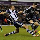 West Brom's Gareth McAuley, left, competes for the ball with Chelsea's Fernando Torres during the English Premier League soccer match between West Bromwich Albion and Chelsea at The Hawthorns Stadium in West Bromwich, England, Tuesday, Feb. 11, 2014
