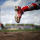 St. Louis Cardinals' Peter Bourjos runs out onto the field during the in the second inning of an exhibition spring training baseball game against the Miami Marlins, Tuesday, March 25, 2014, in Jupiter, Fla The Associated Press