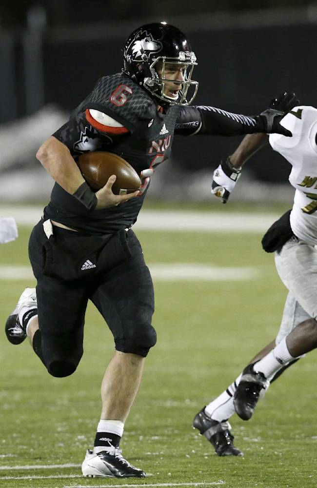 In this Nov. 26, 2013 file photo, Northern Illinois quarterback Jordan Lynch heads for the end zone past Western Michigan cornerback Ronald Zamort (7) during the second half of an NCAA football game in DeKalb, Ill. Lynch was one of six Heisman Trophy finalists invited Monday to the ceremony along with overwhelming favorite Jameis Winston of Florida State and last year's winner Johnny Manziel of Texas A&M