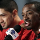 Louisville guard Russ Smith talks to reporters during a news conference, Saturday, March 30, 2013, in Indianapolis. Louisville is scheduled to play Duke in the Midwest Regional final in the NCAA college basketball tournament on Sunday. At left is guard Peyton Siva. (AP Photo/Kiichiro Sato)