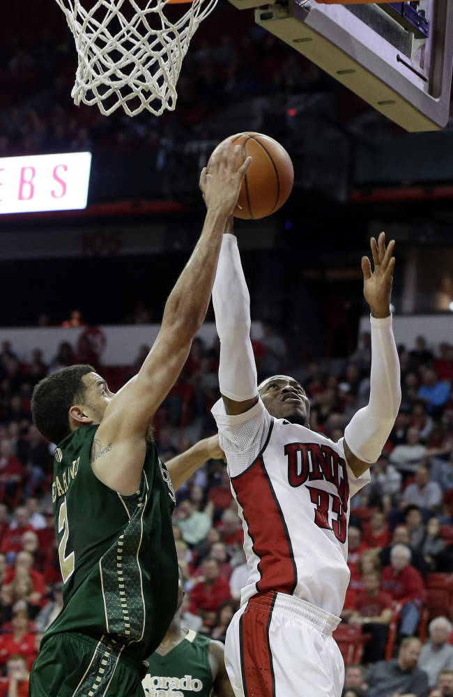 UNLV's Deville Smith shoots covered by Colorado State's Daniel Bejarano during the second half of an NCAA college basketball game on Wednesday, Feb. 26, 2014, in Las Vegas. UNLV defeated Colorado State 78-70