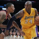 Los Angeles Lakers guard Kobe Bryant (24) drives against Portland Trail Blazers guard Damian Lillard, left, during the second