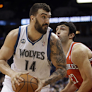 Minnesota Timberwolves' Nikola Pekovic, left, of Montenegro, is closely watched by Milwaukee Bucks' Zaza Pachulia of Georgia in the first quarter of an NBA basketball game, Tuesday, March 11, 2014, in Minneapolis The Associated Press