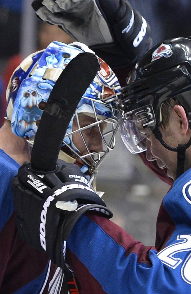 Colorado Avalanche goalie Semyon Varlamov (1) from Russia is congratulated by Paul Stastny (26) following the team's 4-2 win over the Minnesota Wild in Game 2 of an NHL hockey first-round playoff series on Saturday, April 19, 2014, in Denver. The Avalanche beat the Wild 4-2