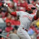 Cincinnati Reds' Roger Bernadina follows through on an RBI-double during the fifth inning of the MLB National League baseball game against the St. Louis Cardinals Monday, April 7, 2014, in St. Louis The Associated Press